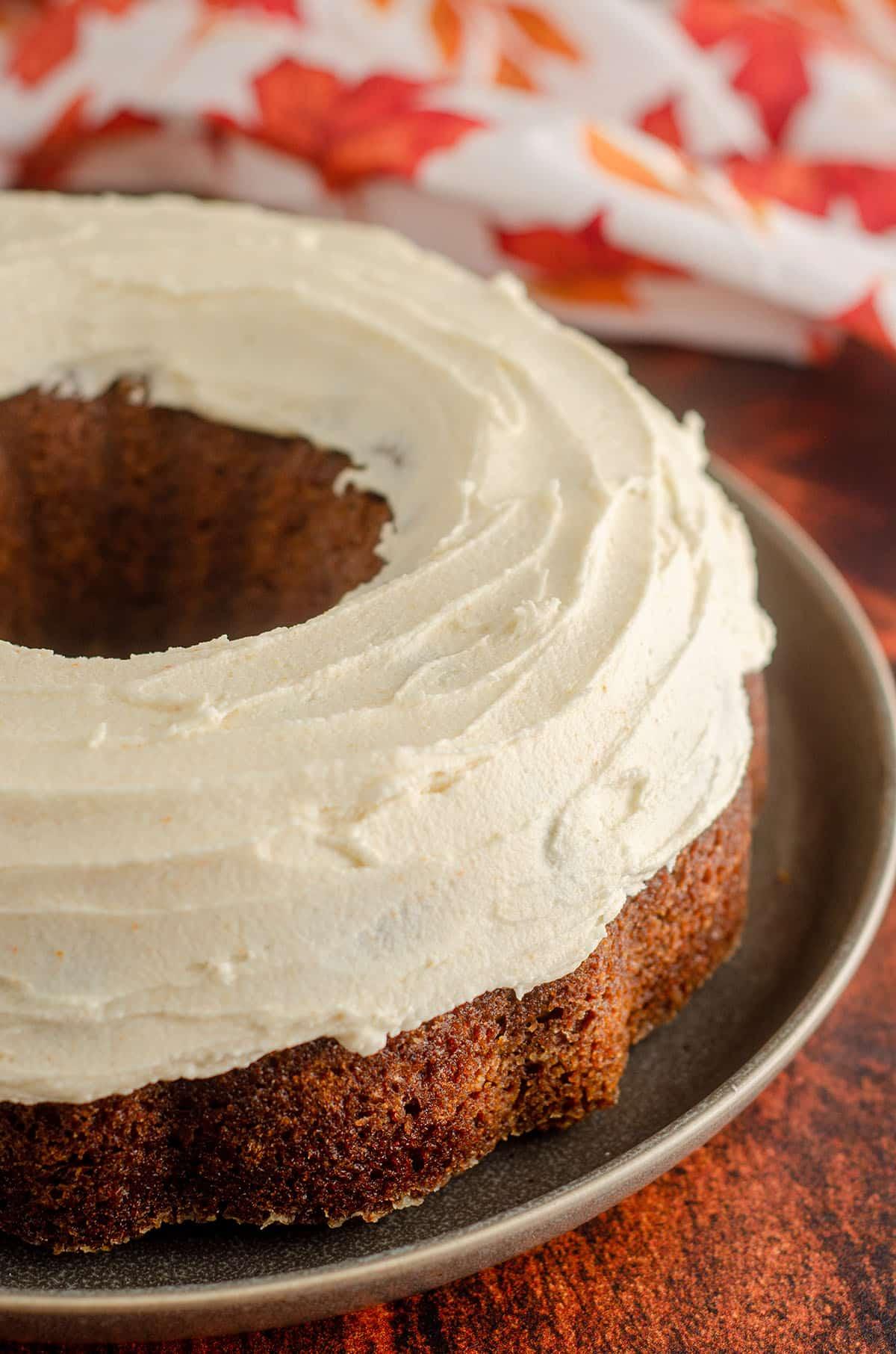 pumpkin bundt cake with brown butter buttercream on top