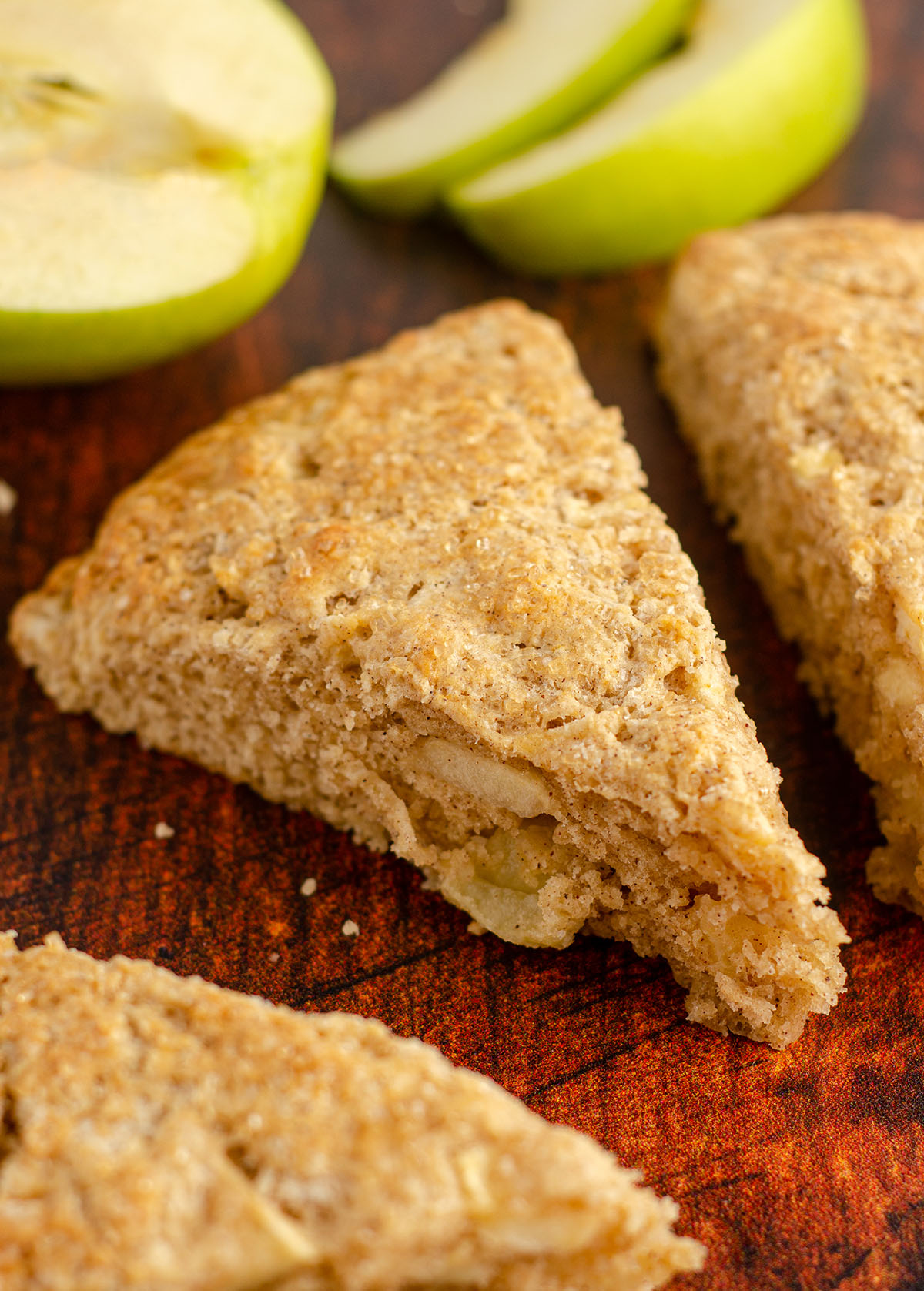 an apple scone with granny smith apple slices in background