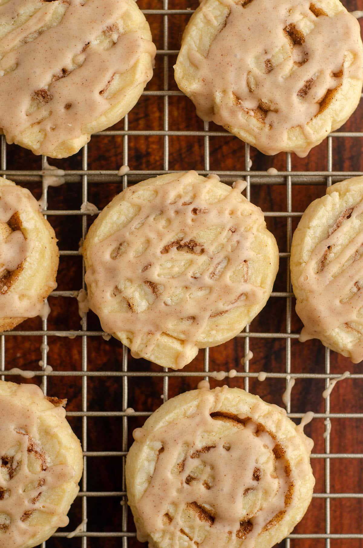 aerial photo of cinnamon pinwheel cookies on a wire cooling rack