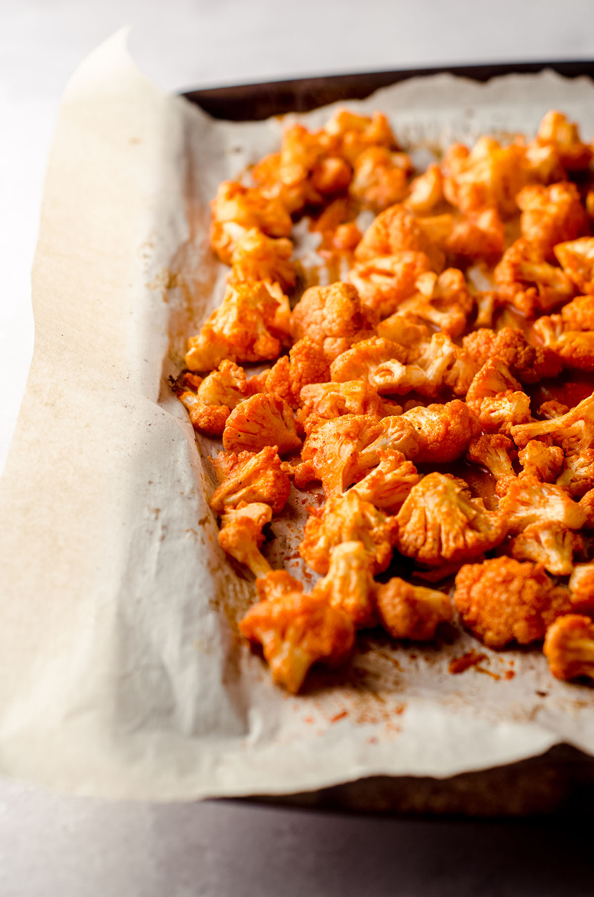 oven baked cauliflower covered in hot sauce to make the filling for buffalo cauliflower tacos