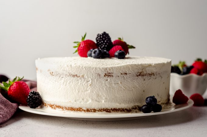 berry cake with fresh berries on top