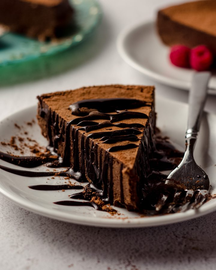 a slice of gluten free dairy free chocolate cake on a plate