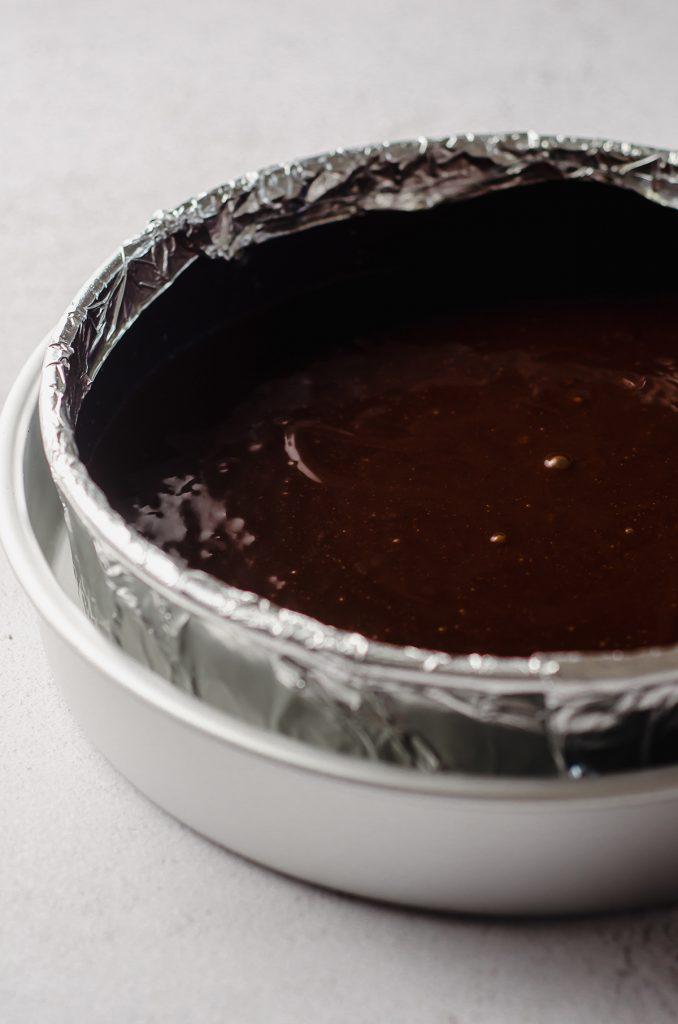 gluten free dairy free chocolate cake batter in a springform pan