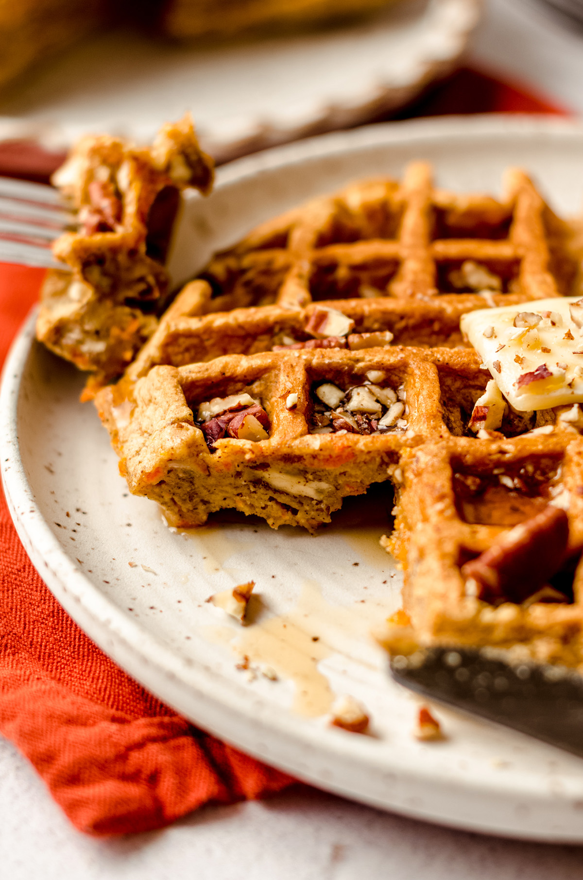 carrot cake waffle with a bite taken out of it