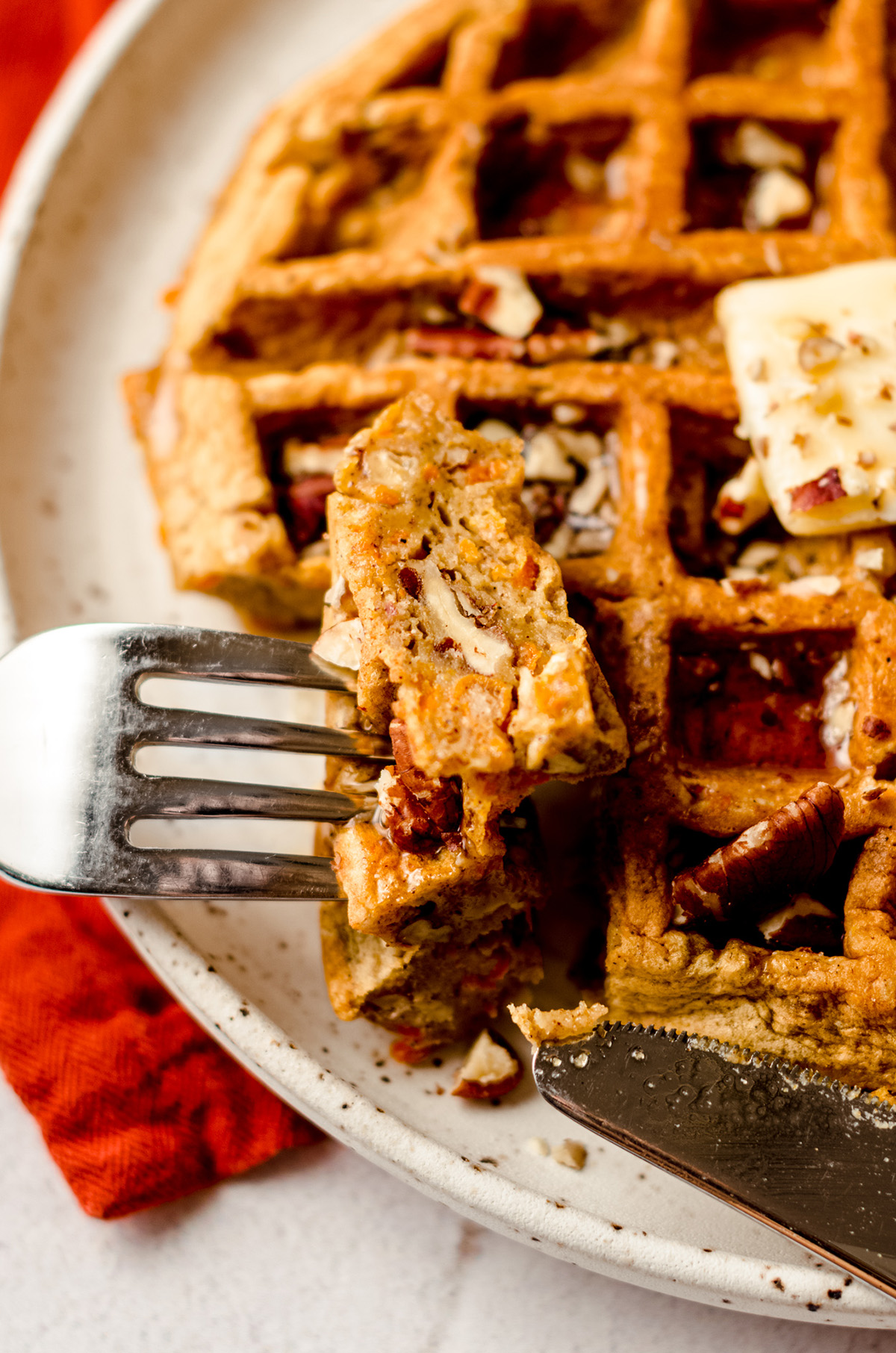 carrot cake waffle with a fork