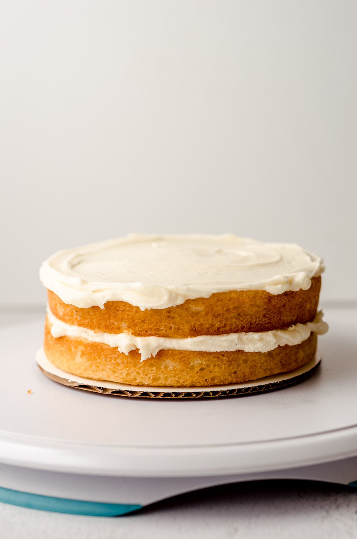 two layers of cake with frosting on them ready to stack
