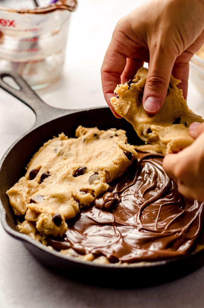 assembling a nutella stuffed cookie cake