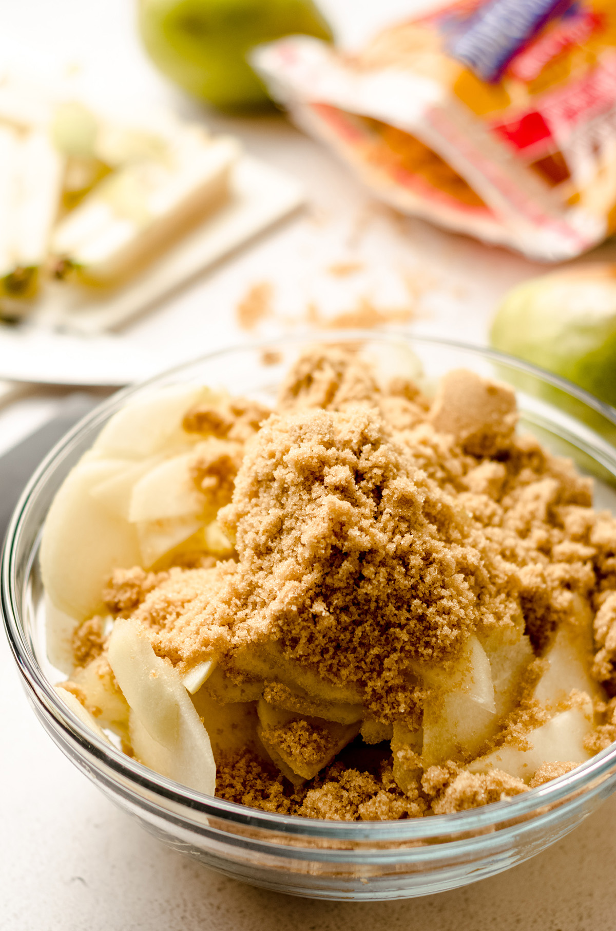 sliced pears in a bowl with cinnamon and brown sugar