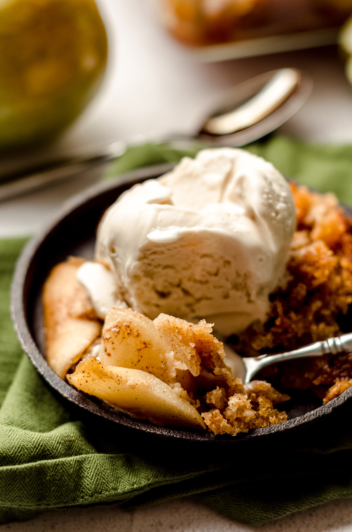pear cobbler with a scoop of ice cream on top