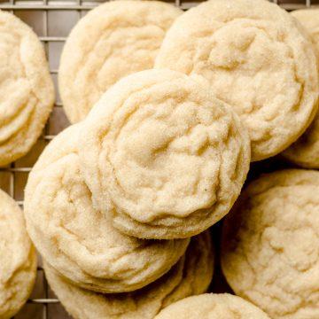 aerial photo of vanilla bean sugar cookies on a cooling rack