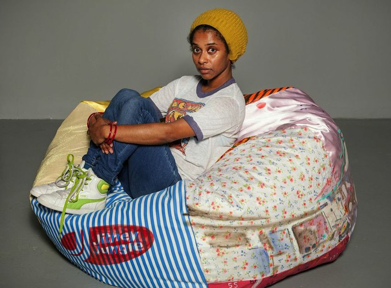 Tameka Norris with bean bag chair, October 2014