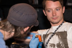 Elijah Wood getting a Fantastic Fest tattoo at the closing party last night.