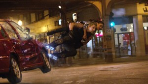 Channing Tatum takes Mila Kunis for a ride on his rocket boots in JUPITER ASCENDING. Photo courtesy of Warner Bros.