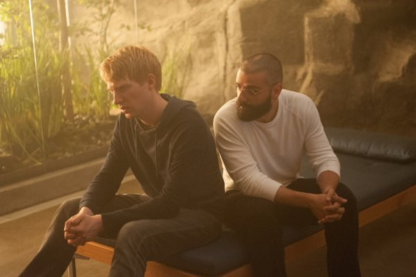 Domhnall Gleeson and Oscar Isaac star in EX MACHINA. Photo courtesy of Universal Pictures.