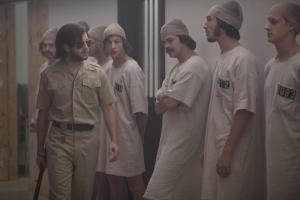 Left, Michael Angarano plays one of the guards, while Tye Sheridan, Johnny Simmons, Ezra Miller and Chris Sheffield play the prisoners of the Stanford experiment. Photo courtesy of IFC Films.