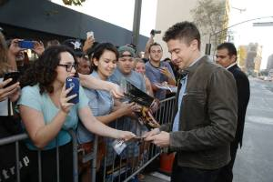 Topher Grace signs for his fans at the AMERICAN ULTRA World Premiere. Photo courtesy of American Ultra's Facebook.
