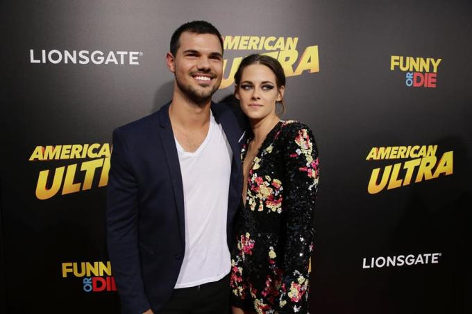 """They're not in Forks anymore. Kristen Stewart and Taylor Lautner reunite on the AMERICAN ULTRA World Premiere red carpet."""