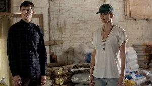Nicholas Hoult and Charlize Theron team up again for DARK PLACES. Photo courtesy of A24.
