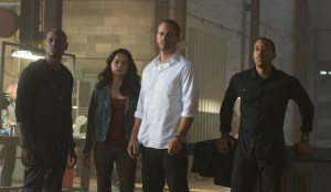 "Tyrese Gibson, Michelle Rodriguez, Paul Walker and Chris ""Ludacris"" Bridges in FURIOUS 7. Photo courtesy of Universal Pictures"