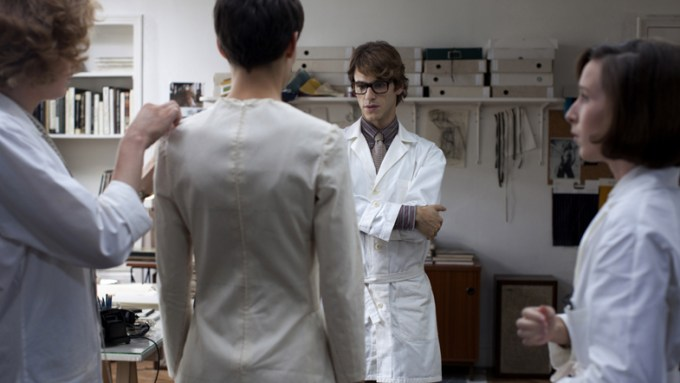 Gaspard Ulliel checks out his garment in SAINT LAURENT. Courtesy of Sony Pictures Classics.