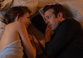 Jake (Sudiekis) and Lainey (Brie) right in the middle of Netflix & Chill. (photo courtesy of IFC.)