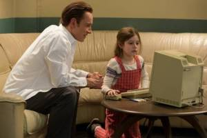 Michael Fassbender stars as the co-founder of Apple Inc. in STEVE JOBS, with Makenzie Moss as his young daughter Lisa. Photo courtesy of Universal Pictures.