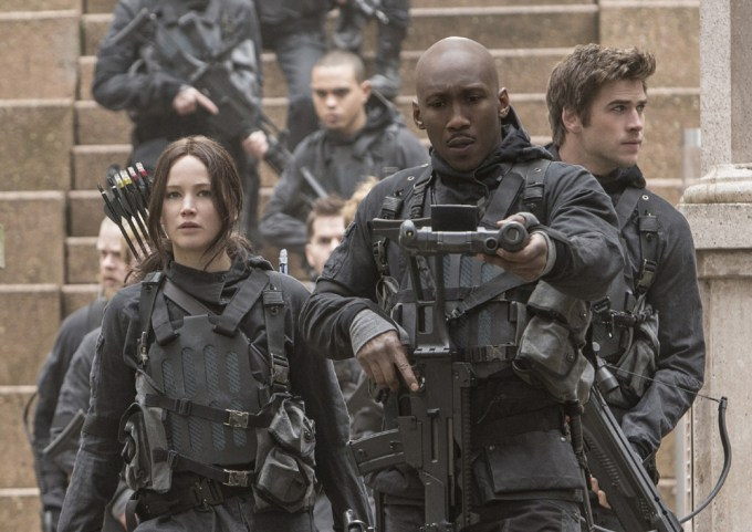 Katniss Everdeen (Jennifer Lawrence, left), Boggs (Mahershala Ali, center) and Gale Hawthorne (Liam Hemsworth, right) in THE HUNGER GAMES: MOCKINGJAY – PART 2. Photo Credit: Murray Close
