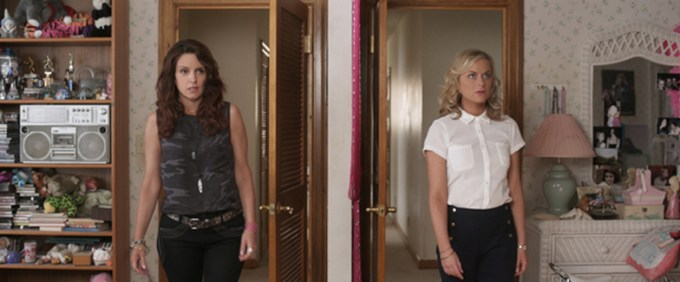 Tina Fey and Amy Poehler survey their bedroom in SISTERS. Courtesy of Universal Pictures.