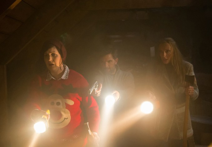 Allison Tolman, Adam Scott and Toni Collette find something horrific in the attic in KRAMPUS. Courtesy of Universal Pictures.