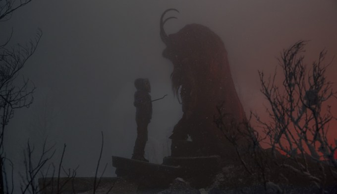 Max (Emjay Anthony) stares down Krampus in KRAMPUS. Courtesy of Universal Pictures