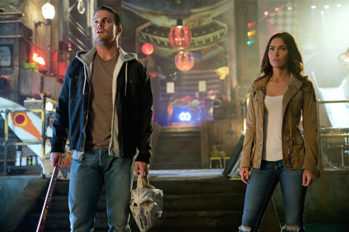 Stephen Amell and Megan Fox are in awe in TMNT 2. Courtesy of Paramount Pictures.