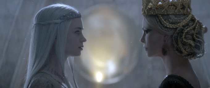 Emily Blunt and Charlize Theron in THE HUNTSMAN: WINTER'S WAR. Courtesy of Universal Pictures.
