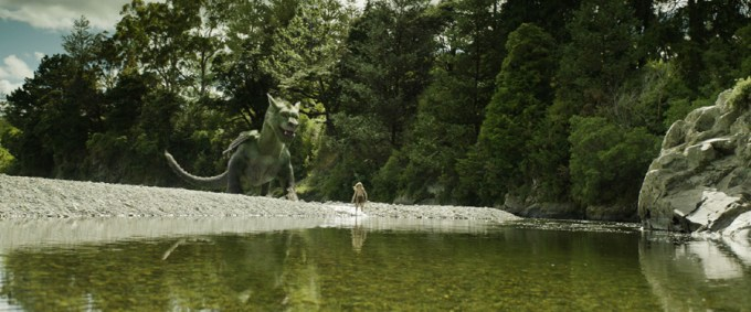 Pete (Oakes Fegley) and his best friend Elliot in PETE'S DRAGON. Courtesy of Walt Disney Pictures.