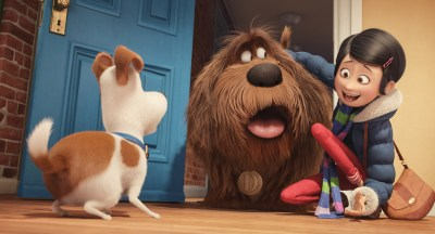 Katie (Ellie Kempler) brings home a new dog (Eric Stonestreet) to play with Max (Louis C.K.). Photo courtesy of Illumination Entertainment.
