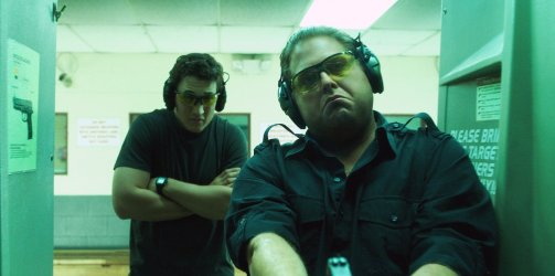 Miles Teller (left) Jonah Hill (right) popping off a few rounds. (Photo courtesy of Warner Bros.)