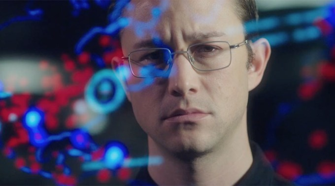 Joesph Gordon-Levitt crunching the numbers as Edward Snowden in SNOWDEN (photo courtesy of Open Road)