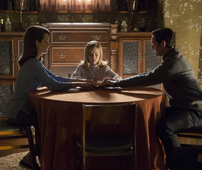 Elizabeth Reaser, Lulu Wilson and Henry Thomas in OUIJA: ORIGIN OF EVIL. Courtesy of Universal Pictures.
