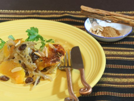 Moroccan Squash with Caramelized Onions pictured with Ceylon cinnamon in the background.