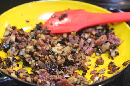 Cook onions, chiles and mushrooms.  Add olives and then the cheese.
