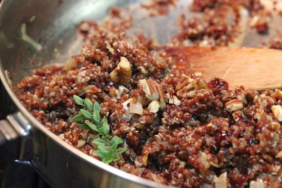 Mixing up the quinoa stuffing ingredients.