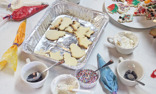 The young bakers work the Sugar Cookie assembly line.