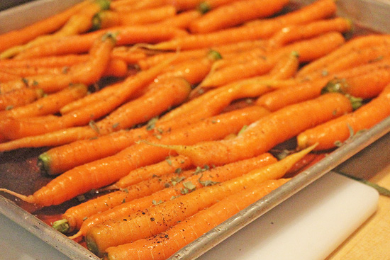 Fresh carrots with sage ready for the oven.