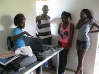 Versia showing her work to Mark King, Sheena Rose and Alicia Alleyne