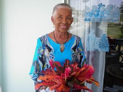 Anita Daniel with a gem from her lush garden.