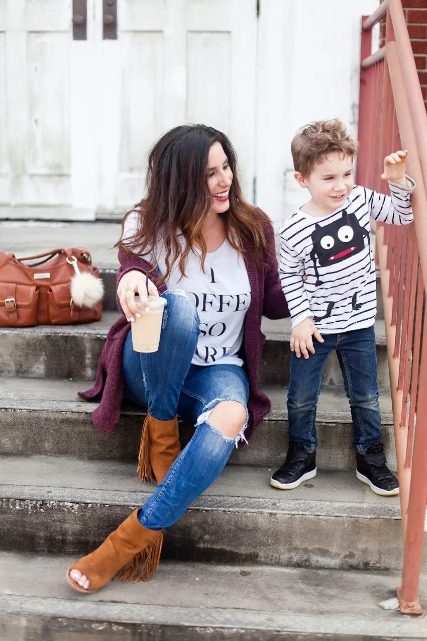 Sharing love through the noise with whispers. And rocking this I Coffee So Hard statement tee! Styled with skinnies and a cardigan for comfortable fashion... and the t-shirt gives back too!! Every tee purchased helps feed hungry families. From Tabitha Blue of Fresh Mommy Blog.