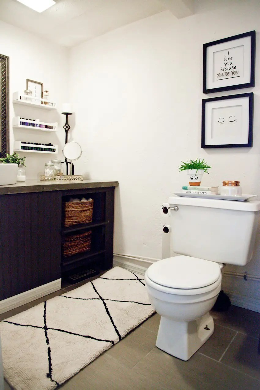 Simple Taking it Our light and bright simple studio bathroom remodel A Before and After