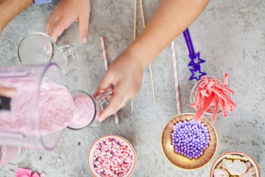 These Epic Royal Crazymilkshakes are indulgentlyMAGICAL! A rich, thick strawberry milkshake is topped with a sugaringof sprinkles and candies to make a delicious drink fit for aprincess... or a prince. A pretty in pink and purple freak shake!