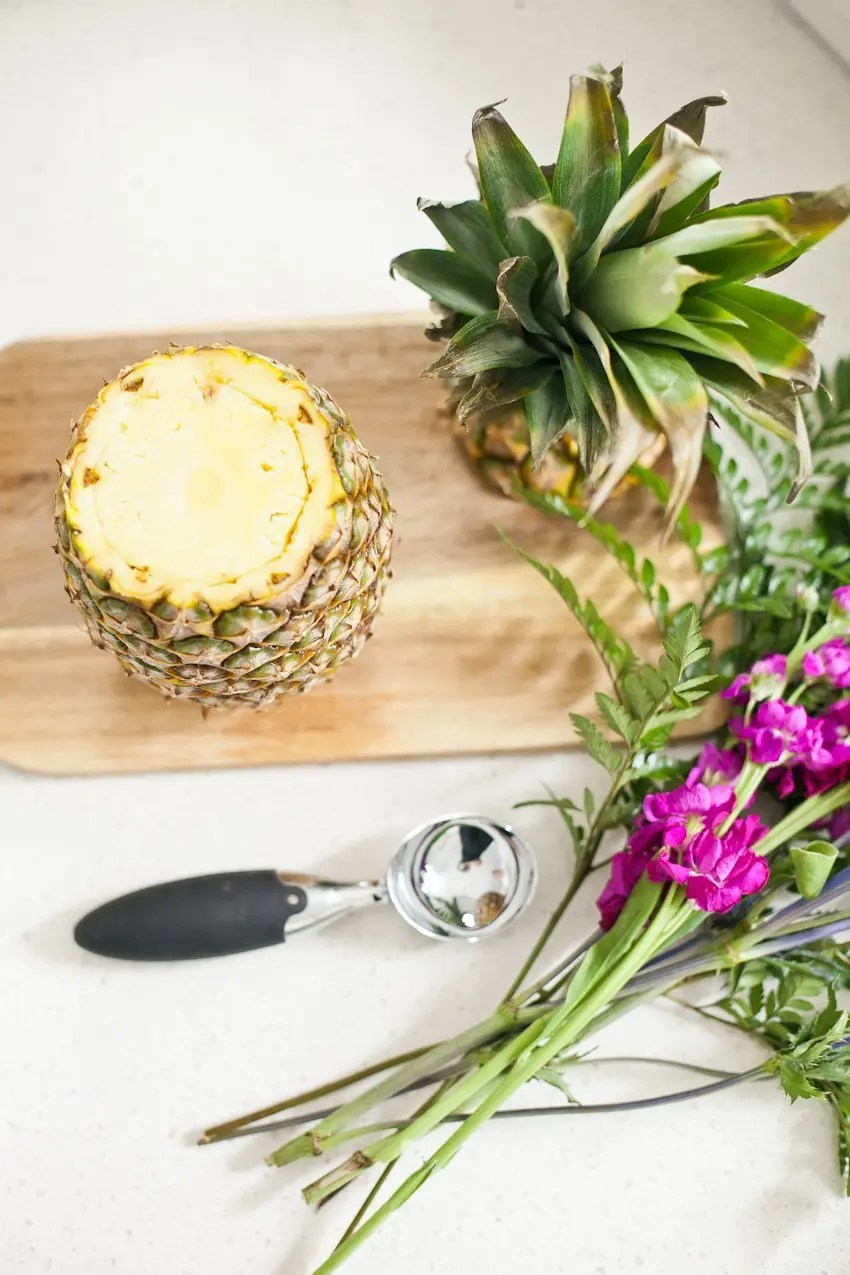 Pineapple Flower Arrangement for garden parties or a summer tropical fete! This DIY Pineapple vase is an easy to make centerpiece or perfect for a Tiki bar!