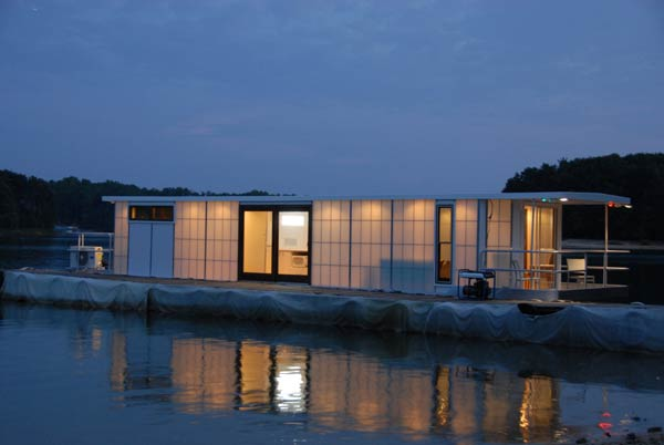 6 metroship nightime side Contemporary Luxury Houseboat with a Loft Style Interior