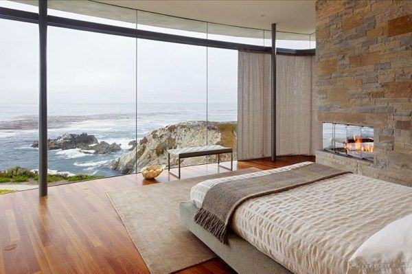 master bedroom with oceanfront view of pacific Spectacular House by the Ocean from Sagan Piechota Architecture